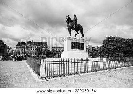 Monument to Henry IV in Paris. Black and white art monochrome photography. Black and white creative photography. Black and white conceptual image. Beautiful black and white background. poster