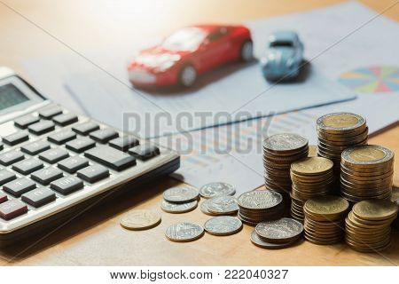 Toy car with calculator and money. concept business finance and insurance