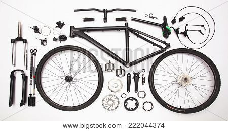 top view still life of bicycle parts, and equipment on the white background
