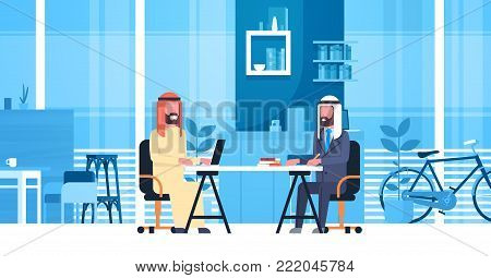 Arabic Business Men Sitting At Office Desk In Modern Coworking Space Working Together Muslim Workers In Coworkers Center Flat Vector Illustration
