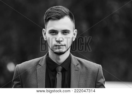 Black and white art monochrome photography. Black and white creative photography. Black and white conceptual image. Beautiful black and white background. Black and white portrait. Portrait of successful businessman in dark business suit