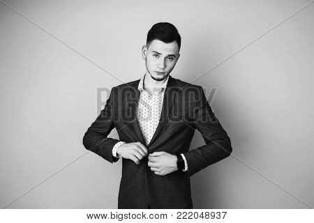 Black and white art monochrome photography. Black and white creative photography. Black and white conceptual image. Beautiful black and white background. Black and white portrait. Successful young businessman with a business suit