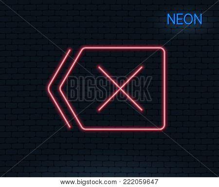 Neon light. Delete line icon. Remove sign. Cancel or Close symbol. Glowing graphic design. Brick wall. Vector