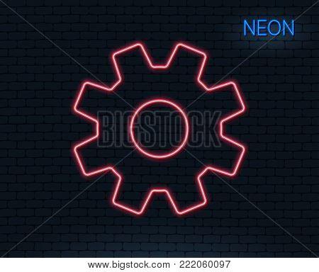 Neon light. Cogwheel line icon. Service sign. Transmission Rotation Mechanism symbol. Glowing graphic design. Brick wall. Vector