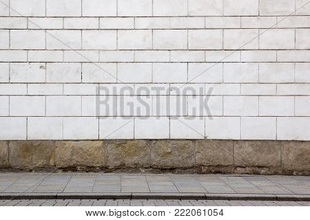 White brick wall and stone sidewalk,  background