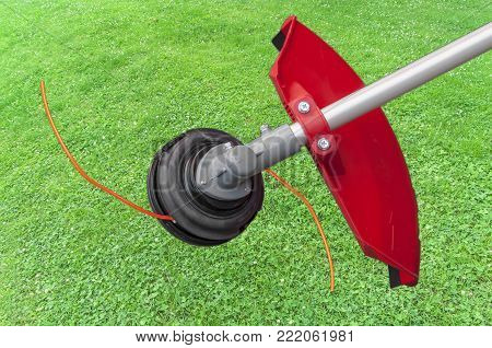 Lawnmower big head trimmer for grass like garden machine with green grass background