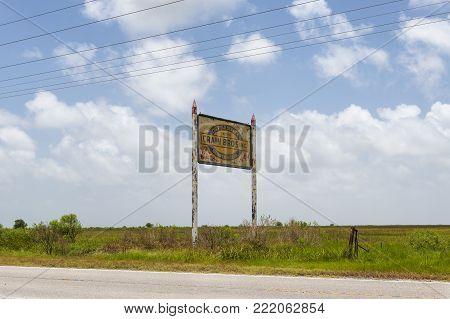 Lake Charles, Louisiana- June 15, 2014: An old and rusty billboard along a roud near Lake Charles, Louisiana, USA