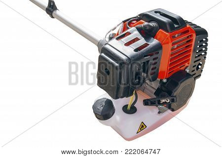 Motor of lawnmower trimmer for grass like garden machine on white