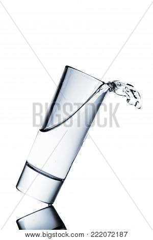 water spilling from glass isolated on white