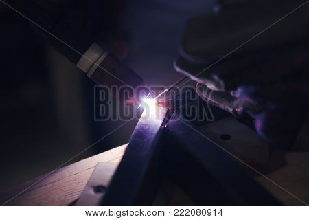 the welding process closeup. the flame from the argon welded.