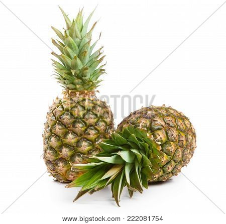 two big pineapples on a white background isolated