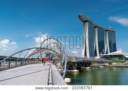 SINGAPORE - JULY 10, 2016: Cityscape of Singapore skyline and skyscrapers on Marina Bay in daynoon light, the most famous tourist attraction in Singapore city, Singapore