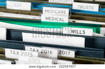 Close up of a well organized home filing system with tabs for each subject and focus on last will and testament