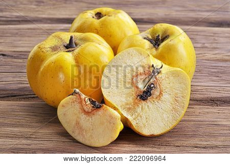 Quince fruits on wooden table.