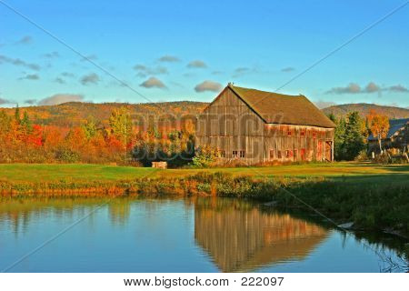 Old Barn Reflecting In Pond