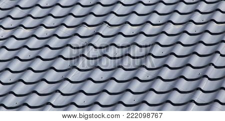 metal roofing roof as background . Photo of an abstract texture