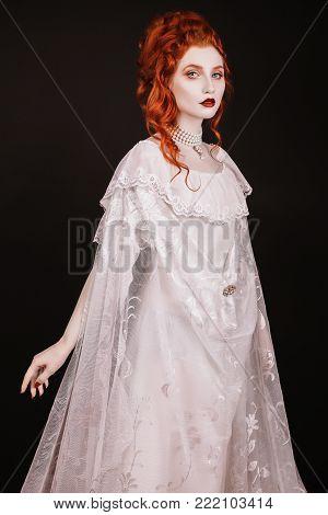 Stylish redhead girl in retro dress posing in studio. Fashion Photo. Beautiful fashion young girl. Sexy fashion young woman. Attractive fashion thin model. Stylish fashionable dress on girl. Fashion concept