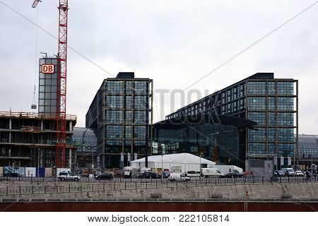 BERLIN, GERMANY - DECEMBER 06: A tower and design element with logo of the Deutsche Bahn and modern architecture of the main station on December 06, 2017 in Berlin.