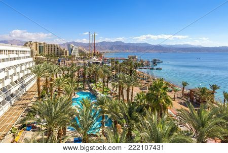 Aerial view on the Red Sea, central public beach and promenade in Eilat - famous vacation spot,  resort and recreational city in Israel and Middle East