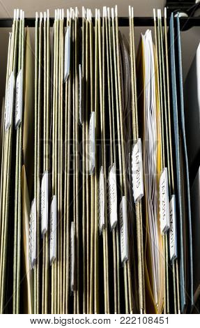 Close up of a well organized home filing system with tabs for each subject with focus on files