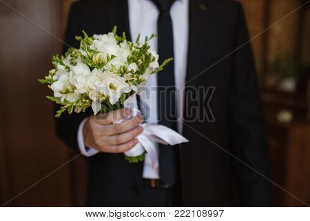 Wedding ceremony. Going to the wedding. Beautiful wedding bouquet. The original wedding gift. The groom in a wedding suit. Wedding flowers