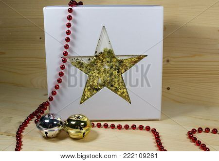 CHRISTMAS GIFT - GIFT BOX WITH GOLDEN STAR/Gift box with golden star and two jingle bells.