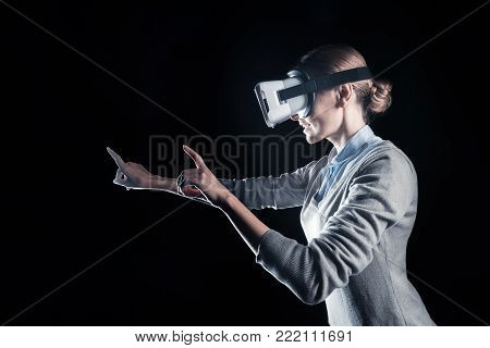 New dimensions. Nice positive delighted woman smiling and being in 3d glasses while experiencing new dimensions