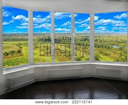 Window with view to the vast picturesque summer landscape