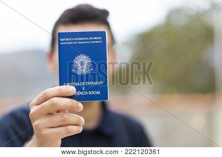 Man holding his work portfolio in hands