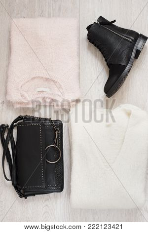 Women Trendy Fashion Clothes Collage With Sweater, Leather Pants, Boots And Bag. Flat Lay