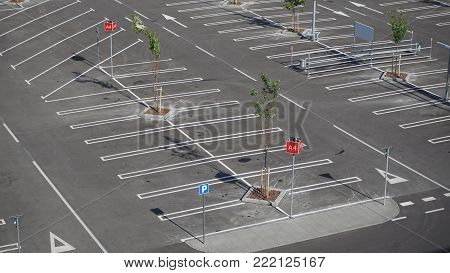An empty parking lot freshly built and painted