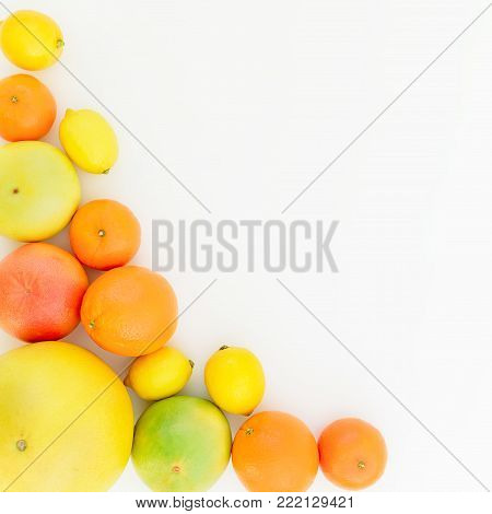 Fruits frame of lemon, orange, grapefruit, sweetie and pomelo on white background. Flat lay, top view. Fruit's background
