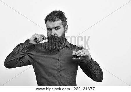 Serious Bearded Man Hipster With Metallic Jar In Leather Jacket