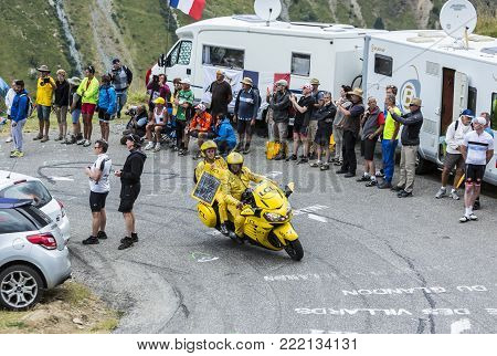 Col du Glandon, France - July 24, 2015: The yellow LCL bike driving on the road to Col du Glandon in Alps, during the stage 19 of Le Tour de France 2015.