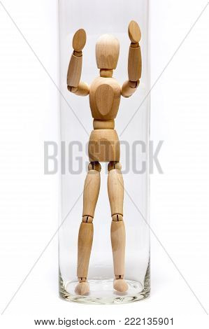 Wooden mannequin trapped in a glass jail
