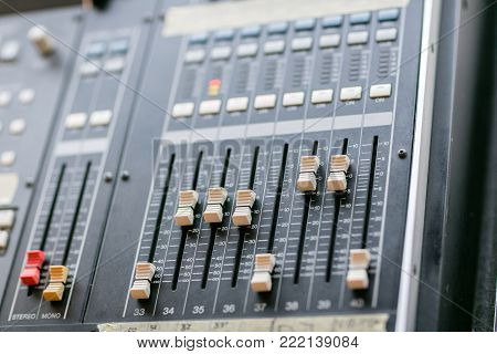 Music mixer equalizer console for mixer control sound device. Sound technician audio mixer equalizer control. Mastering For Radio and TV Broadcast