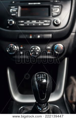close up of gear shift in the car and central console in the background