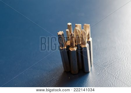 Head for screwdriver (bits) on blue background, Tools collection turn-screw