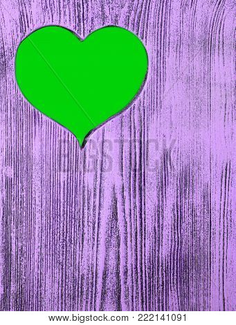 The green heart is carved in a wooden board of purple. Background
