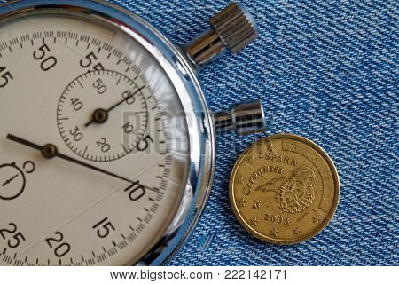 Euro Coin With A Denomination Of 10 Euro Cents (back Side) And Stopwatch On Blue Denim Backdrop - Bu