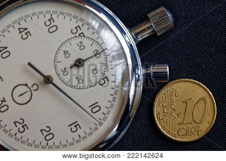 Euro Coin With A Denomination Of Ten Euro Cents And Stopwatch On Black Jeans Backdrop - Business Bac