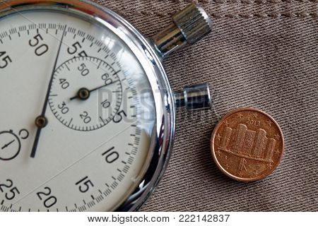 Euro Coin With A Denomination Of 1 Euro Cent (back Side) And Stopwatch On Beige Denim Backdrop - Bus