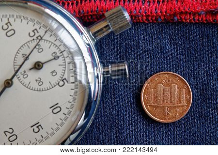 Euro Coin With A Denomination Of 1 Euro Cent (back Side) And Stopwatch On Worn Blue Jeans With Red S