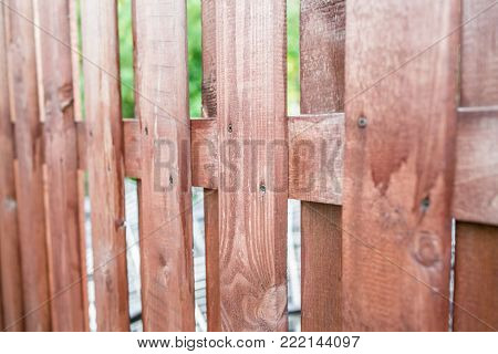 Close up of line light brown wooden fence.striped wooden fence background.vertical wooden fence wall