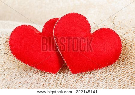 Heart symbol in hands. Concept of health, protection and love. Woman holding heart in her hands.
