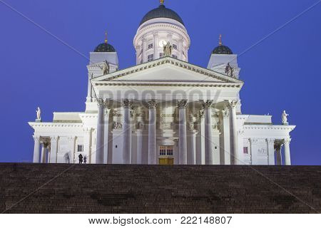 Travel Ideas and Concepts. Renowned Lutheran Cathedral in Helsinki on Senate Square Shot During Blue Hour in Finland.Horizontal Image Orientation