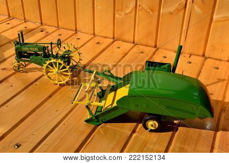 DALTON, MINNESOTA, Sept 8, 2017: A toy General  Purpose tractor and combine are displayed at the annual Dalton Threshing Bee farm show in Dalton held each 2nd full weekend in September where 1000's attend.