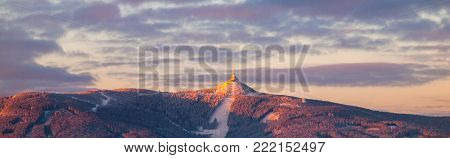 Morning sunrise at Jested Mountain and Jested Ski Resort. Winter time panorama. Liberec, Czech Republic.