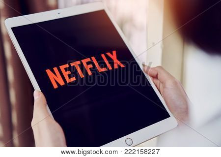 Bangkok, Thailand - January 16, 2018 : Netflix app on tablet screen. Netflix is an international leading subscription service for watching TV episodes and movies.