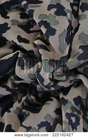 Millitary fabric closeup cloth photo. Millitary pattern green black texture.